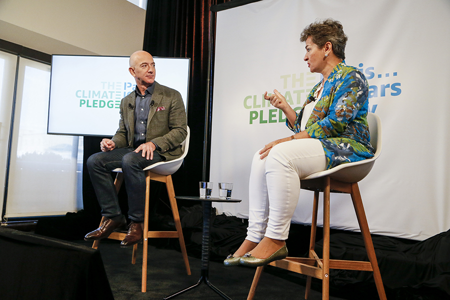 Jeff Bezos and Christiana Figueres. AFP/END