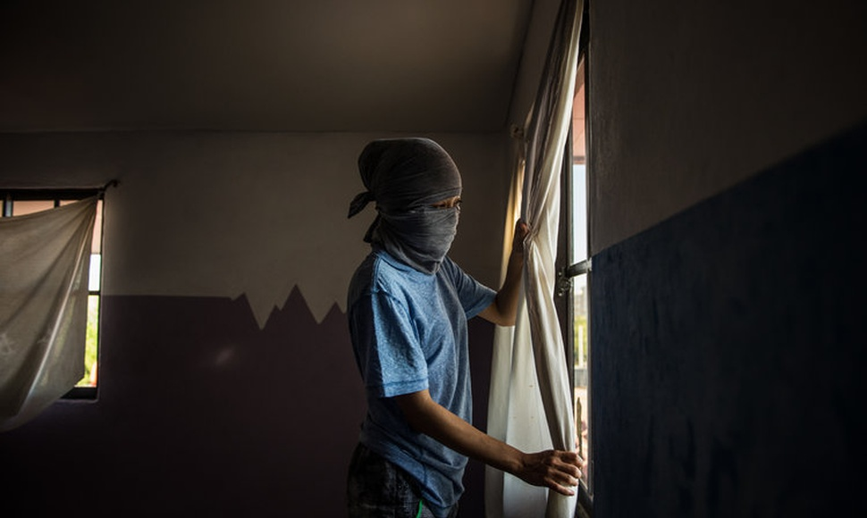 The fugitive protesters worry that their safe house will be infiltrated. They take turns on guard duty at night. (Meridith Kohut for The New York Ti