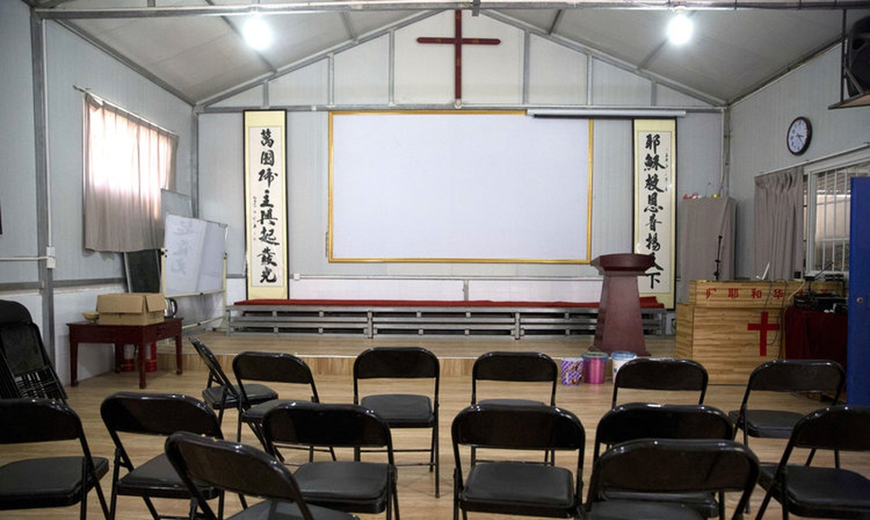 The Chinese authorities have forced a half-dozen places of worship to close. A shuttered church near Nanyang. (Ng Han Guan/Associated Press)