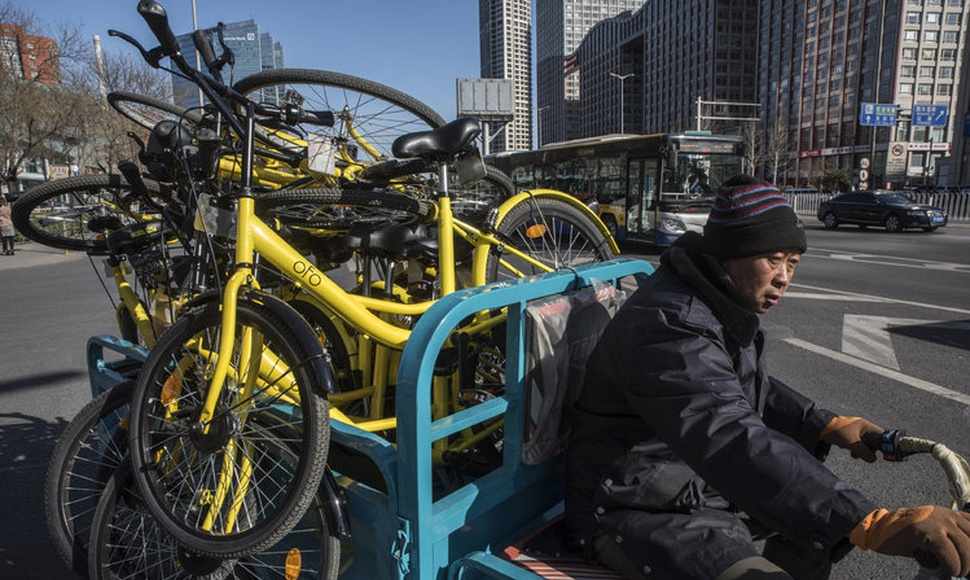 The bike-sharing start-up Ofo has had a run of customers seeking refunds. Its bikes being collected in Beijing. (Gilles Sabrié for The New York Time