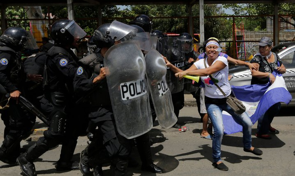 Violent clashes that started over pension cuts have left 322 people dead and 565 jailed. A protest in Managua. (CInti Ocon/Agence France-Presse — Ge